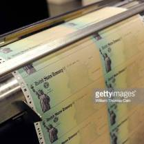 PHILADELPHIA, PA - JULY 18: Blank U.S. Treasury checks run through a printer at the U.S. Treasury printing facility July 18, 2011 in Philadelphia, Pennsylvania. U.S. President Barack Obama recently stated that he can't guarantee retirees will receive their Social Security checks in August if the House and Senate can not reach an agreement on reducing the deficit. (Photo by William Thomas Cain/Getty Images)